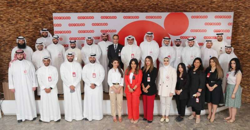 Al-Babtain and company officials and a group shot with the work team