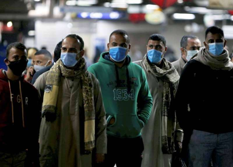 Egyptians wearing a mask in the Cairo metro