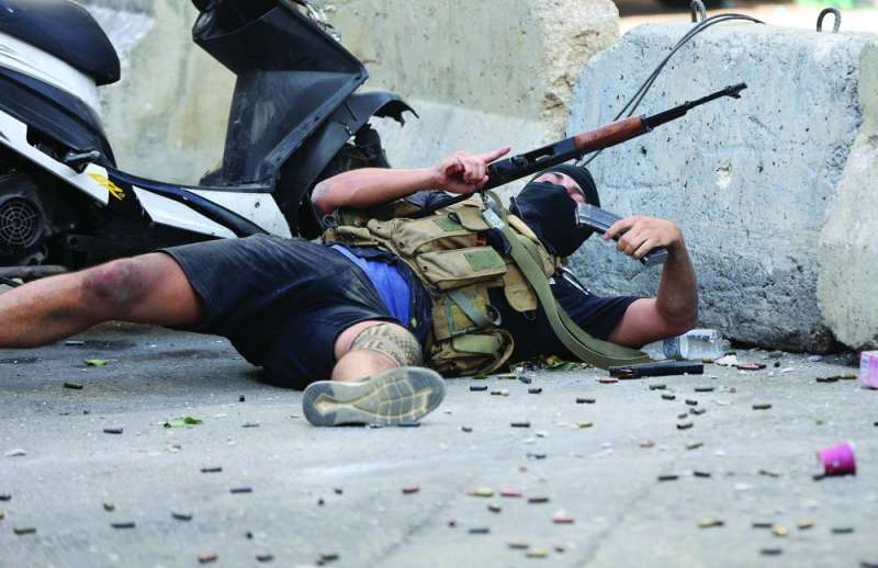 A gunman at the scene of clashes in Beirut (AFP)